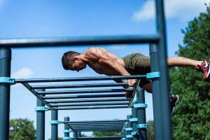 Street workout athlete exercise on monkey bars